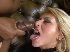 Delightful blonde in stockings has fun with two chocolate dicks