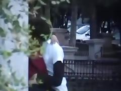 Voyeur tapes a girl couple making-out in public, while masturbating eachother.