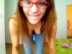 Grinning nerdy girl dances in her underwear