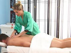 Hot massage slut oils up a client and gives him a tremendous blowjob