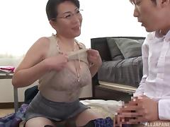 Smart Asian milf in a tight top blows him erotically porn tube video