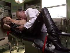 An Asian girl in a leather bodysuit is felt up and fucks in the lab