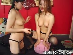 Asian sluts are toy fucking the wet clit and cumming together porn tube video