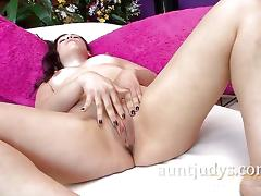 Seductive milf plays with her moist pussy