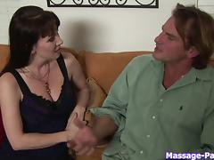 MILF with huge knockers massages and jerks him off porn tube video