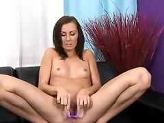 Gorgeous chick is urinating and rubbing bald pussy