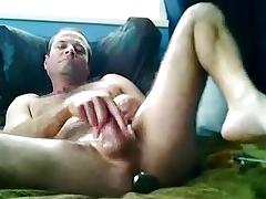 Pretty boy is relaxing in the apartment and memorializing himself on computer webcam