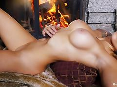 Passionate blonde decides to get naked right by the warm fire