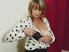 Classy mature chick with a hairy pussy masturbates solo