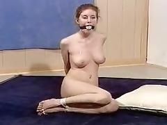 Naked girl bound, gagged and toetied