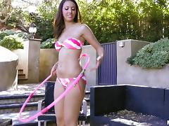 Talented girl hula hoops then toys her pussy out by the pool