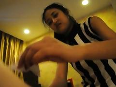 Asian teen lass blowing her BF\'s hard cock