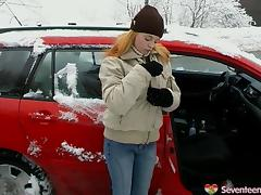 In a snowstorm Tanya fucks herself with a dildo out in her car porn tube video