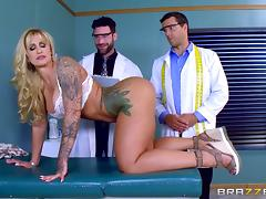 Tattooed babe is here to take two huge peckers at the same time