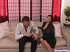 Seriously busty masseuse loves making her clients cum with handjobs