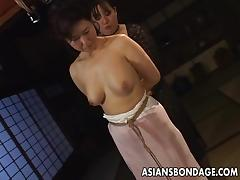 Mature bitch gets roped up and hung in a bdsm session porn tube video
