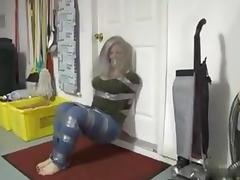 Taped up girl hops around house porn tube video