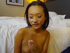 Asian babe riding and taking facial cumshot