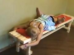 Blonde girl bound to bench
