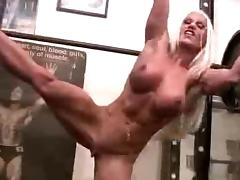 Sexy muscle woman at thr gym
