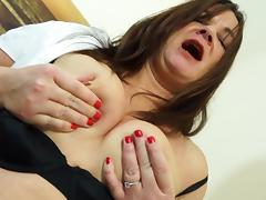 Voluptuous mature babe looks great in stockings and a garter belt tube porn video