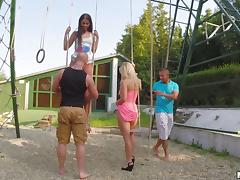 Foursome on the playground with cum craving cock sluts