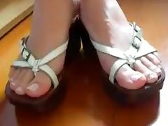 beautiful female feet in open shoes