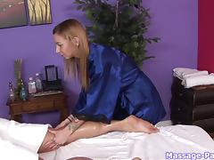 Naughty massage girl with tattoos strokes his dick erotically