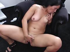Solo brunette stuffs a big black dildo into her wet cunt