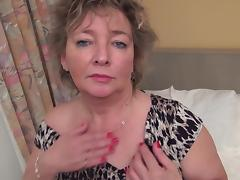 Horny granny gets out her vibrator and makes herself cum