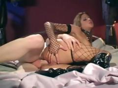 Sexy skank in black fishnets gives a guy some sweet anal sex