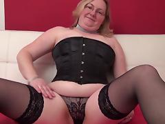 Corset and stockings are super hot on this curvy mama
