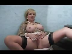 Blonde woman plays with pussy on stairs