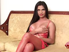 Tranny with a great rack plays with her nips and ass while jerking off