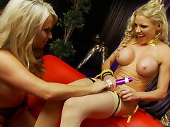 Charming blondes with huge boobs getting pleasure in a lesbian way