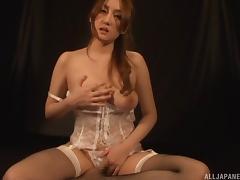 Still in lingerie this Asian honey fingers her wet, hairy gash porn tube video