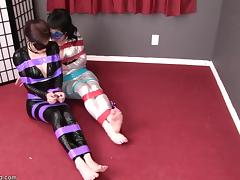 Captured in Catsuits and Bound tube porn video