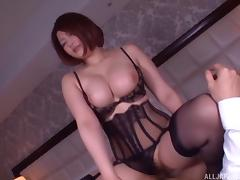 Asian hottie with a big, round ass backs up onto a big cock porn tube video