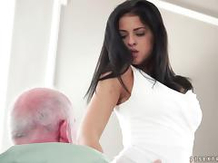 Stimulating black-haired babe poked hard by the experienced guy