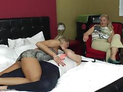 Teen girl goes to bed with a couple of sexy mature babes