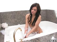 While in the bubble bath Mandy More teases her bald pussy porn tube video