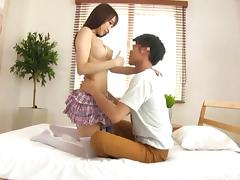 Arousing Japanese chick in a skirt impales her pussy on the dick porn tube video