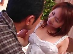 Sexy brunette from Asia gives a nice sucking to her favorite buddy