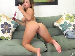 She fucks her pussy with a toy while teasing her ass with a finger