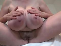 Horny cougar goes naked to show her humongous pair of melons porn tube video