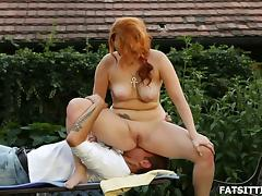Curvaceous redhead feeds her wet pussy to his eager tongue