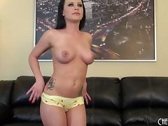 Pornstar stripping to reveal her amazing tits and ass