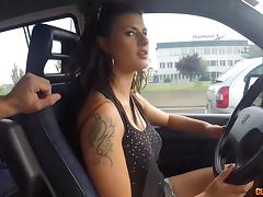 After giving a handjob while she drives he takes her pussy for a ride