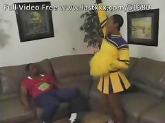Hairy ebony cheerleader on the couch