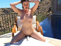 Outdoors in the desert with a couple of toys for her pussy
